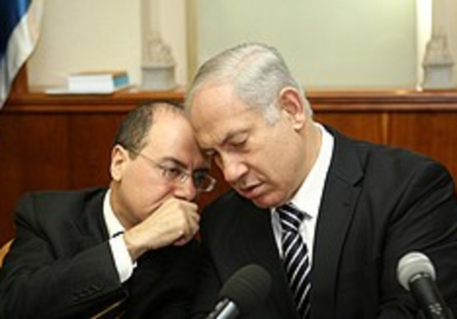 Prime Minister Binyamin Netanyahu listens to Minis