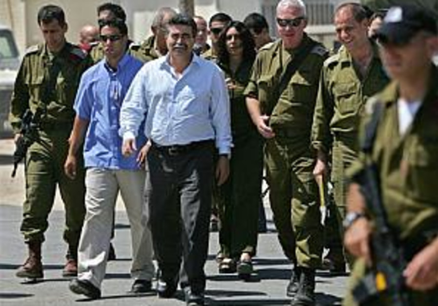 Peretz vows tough response to Hizbullah stone-throwing