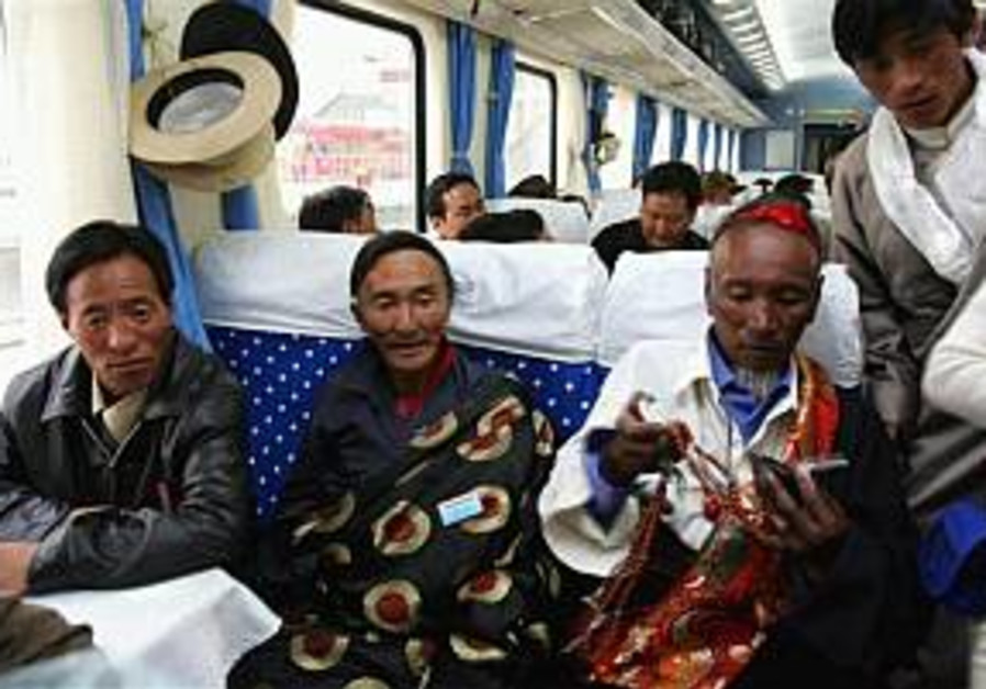 Tibetans sit on the first train to use the Qinghai
