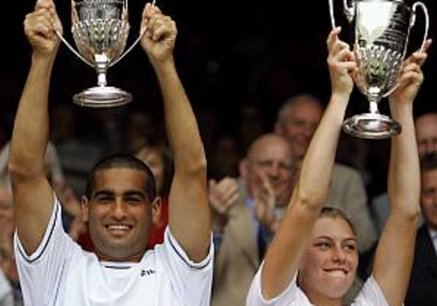 Wimbledon: Ram wins first Grand Slam