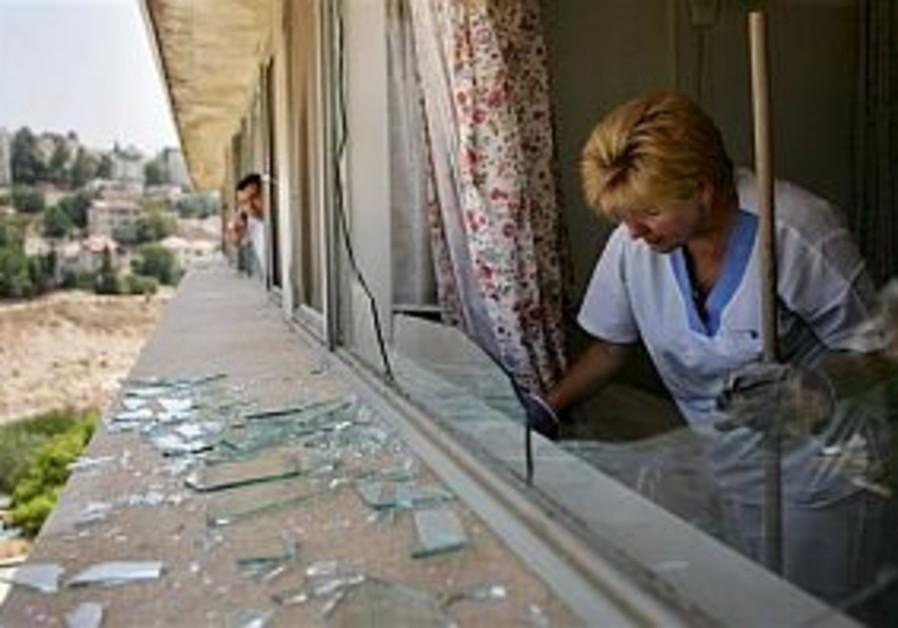 Bint Jbail's hospitalized soldiers relive fight as Haifa siren wails