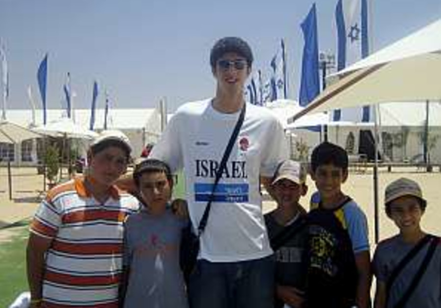 National basketball team raises spirits in Nitzanim camp