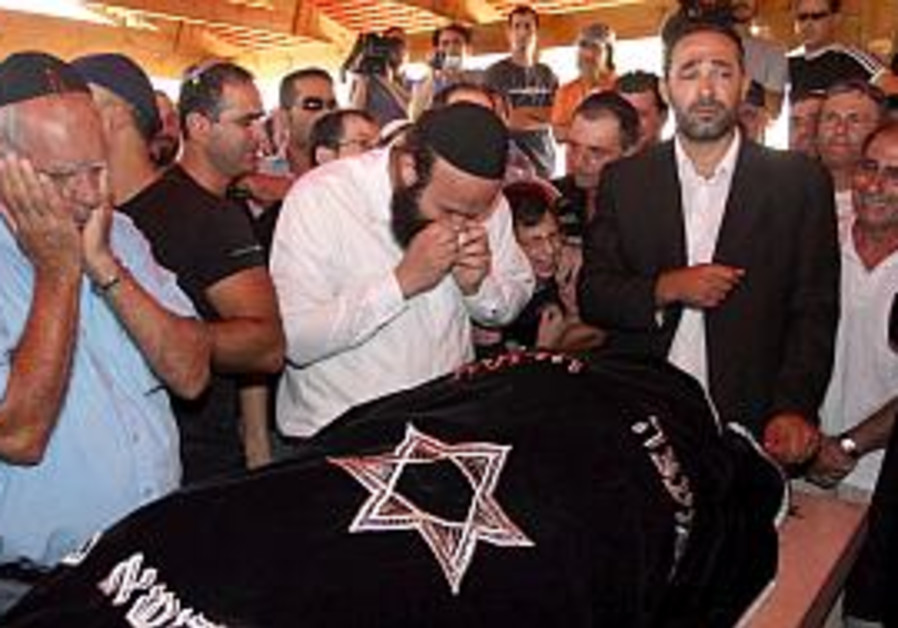 Friday's rocket victims laid to rest