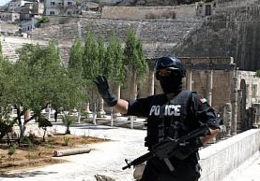 One killed, one arrested in raid on Jordan al-Qaida cell