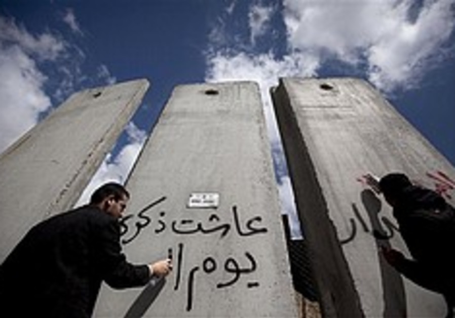 Activists graffiti message on West Bank barrier