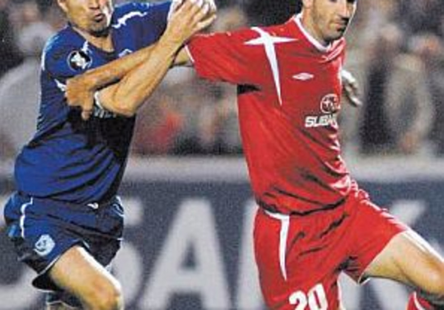 Local soccer: Hapoel stuns Maccabi in TA derby
