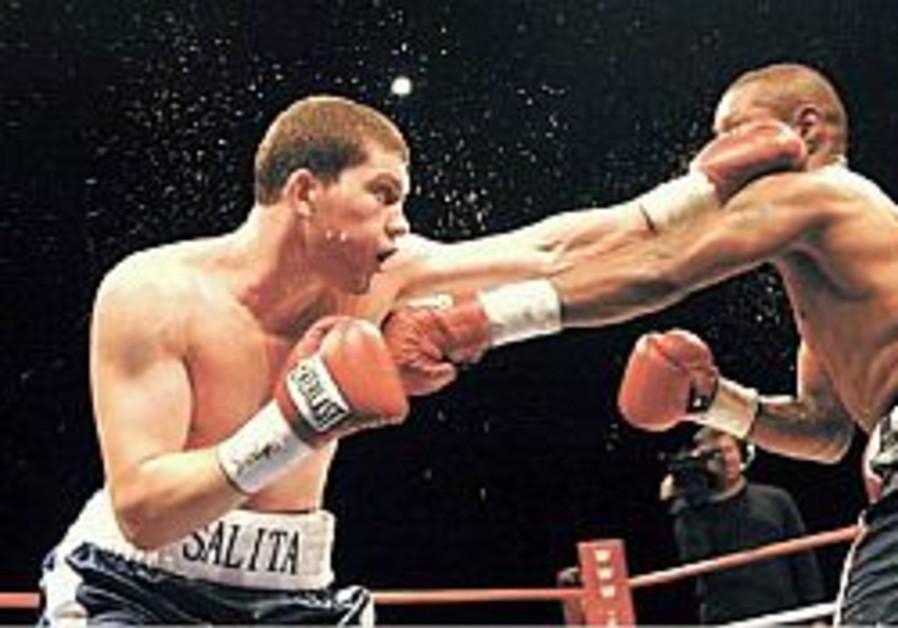 Dmitriy Salita survives cut to win