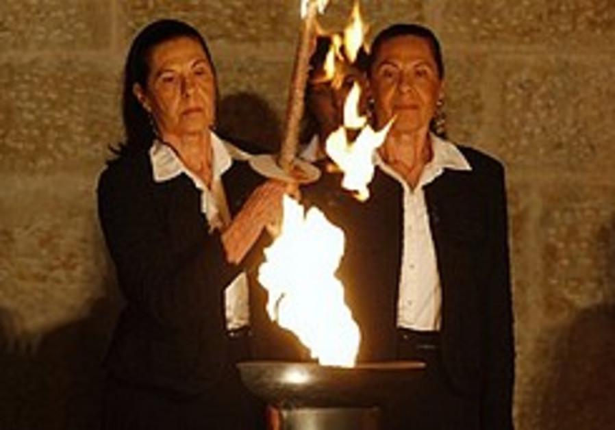 Survivors light torches at Yad Vashem