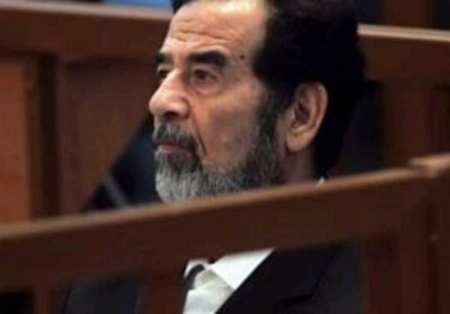 Saddam's chief lawyer warns of more violence in Iraq