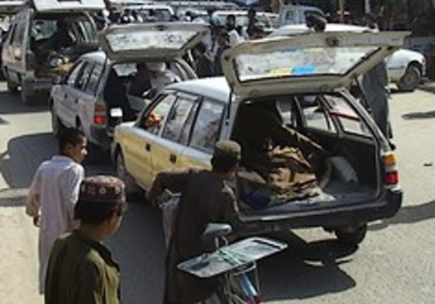 dead afghan in trunk