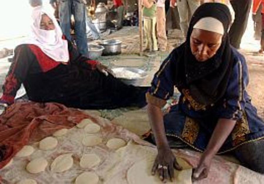 beduin women making bread or something 298 aj