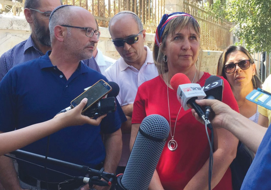 PARENTS OF CHILDREN with cancer hold a press conference.