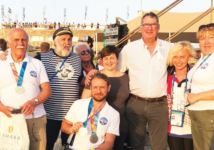 Konstantin Afinogenov (center) shows his Maccabiah medals with fellow team members.