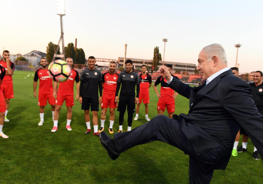 Prime Minister Benjamin Netanyahu visits a soccer practice in Hungary