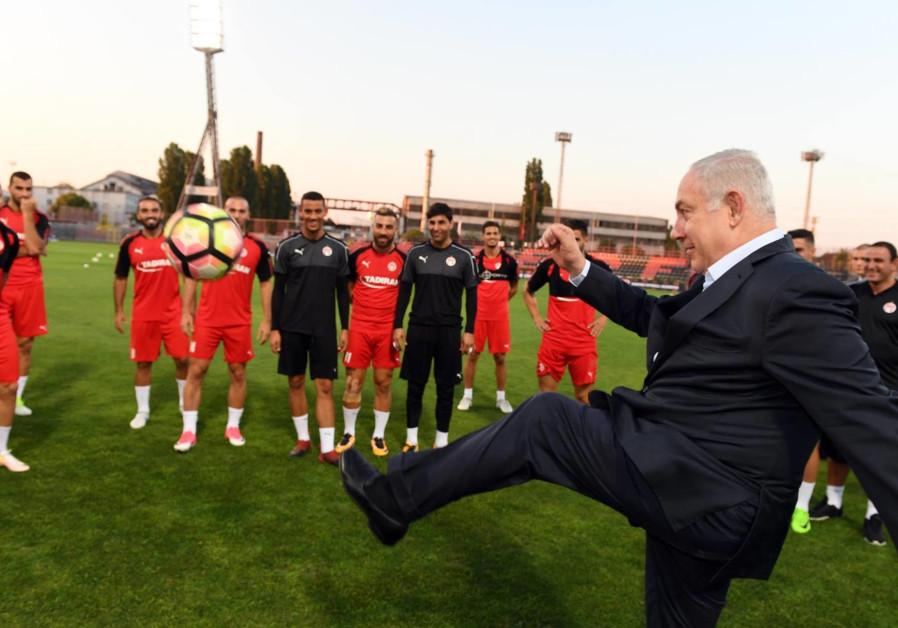 Prime Minister Benjamin Netanyahu visits a soccer practice in Hungary