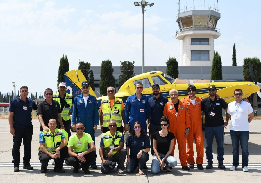The Israeli delegation of firefighters pose in front of a plane in Montenegro.
