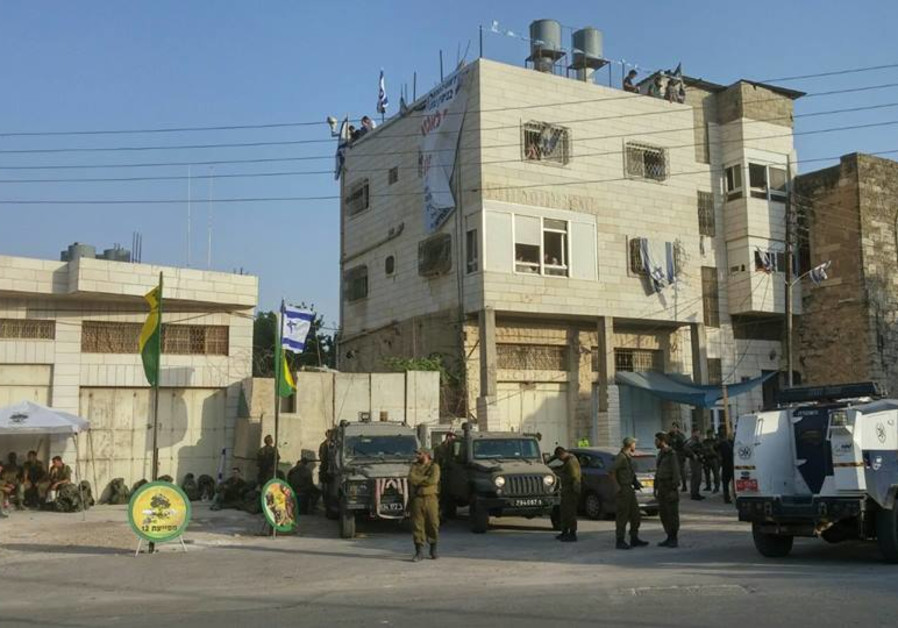 IDF soldiers outside of Beit Hamachpela building in Hebron.