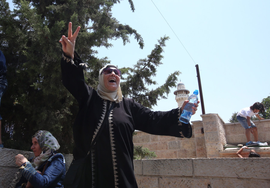 Palestinian women celebrate outside Temple Mount in Jerusalem