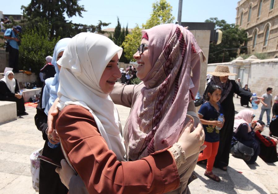 Palestinian women celebrate outside Temple Mount in Jerusalem