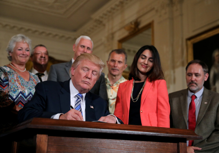 US President Donald Trump signs a proclamation, July 17, 2017.