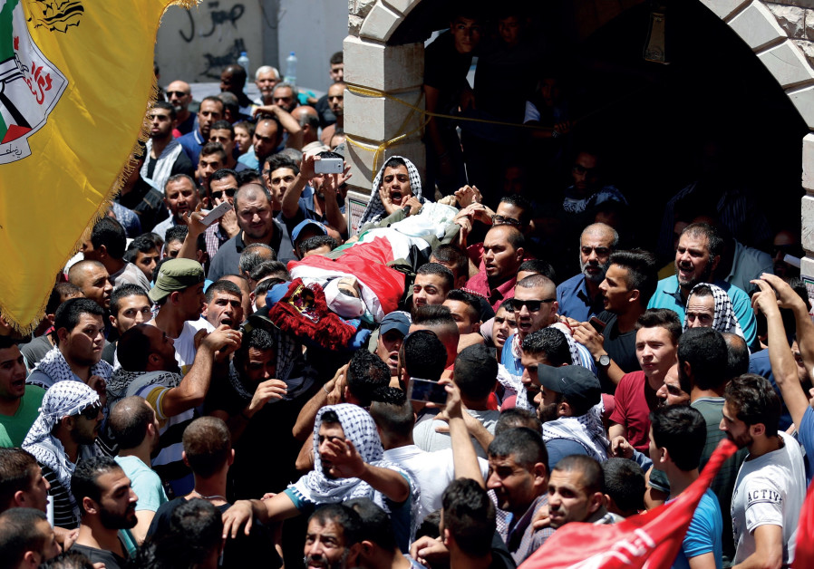 Bara Hamamdah being carried by mourners