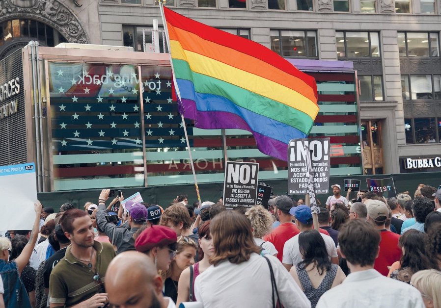 PEOPLE PROTEST US President Donald Trump's ban on transgender service members in the military.