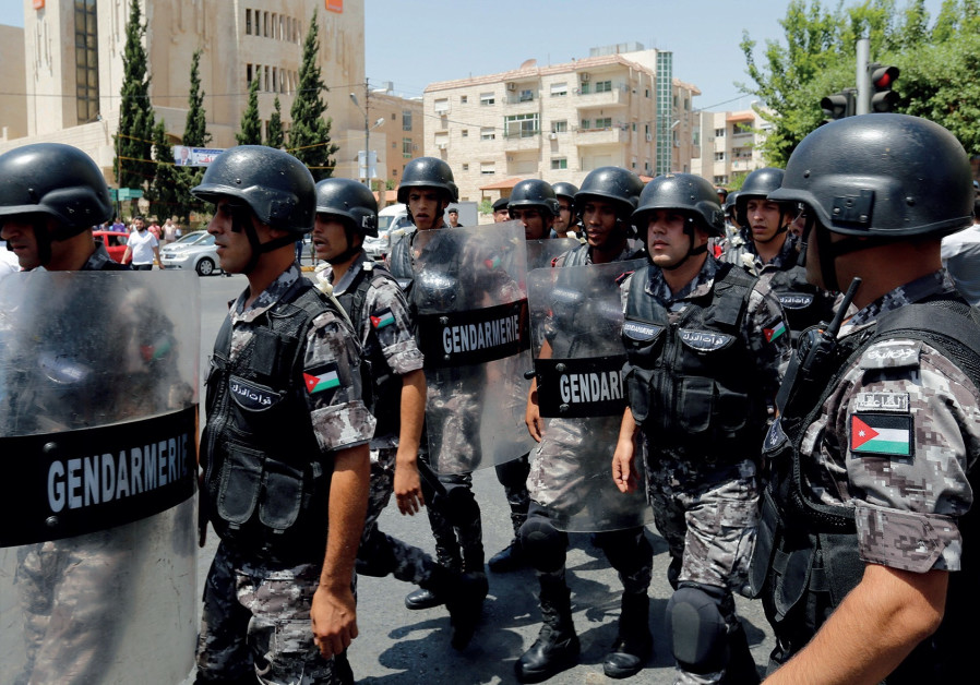 JORDANIAN POLICE deployed during protests against Israel in Amman.