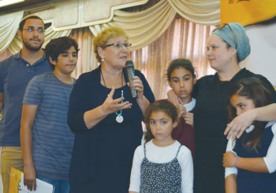 Orphans receive scholarships at Colel Chabad awards ceremony
