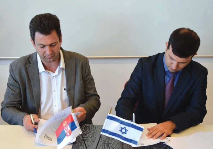 R PAJIC Serbia's assistant minister of education, and Dr. Eyal Kaminka, director of Yad Vashem