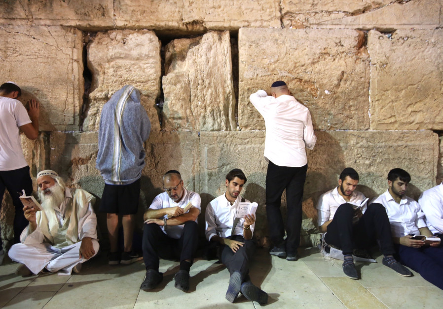 Jews praying at the Western Wall on the eve of Tisha Be'av, July 31, 2017.