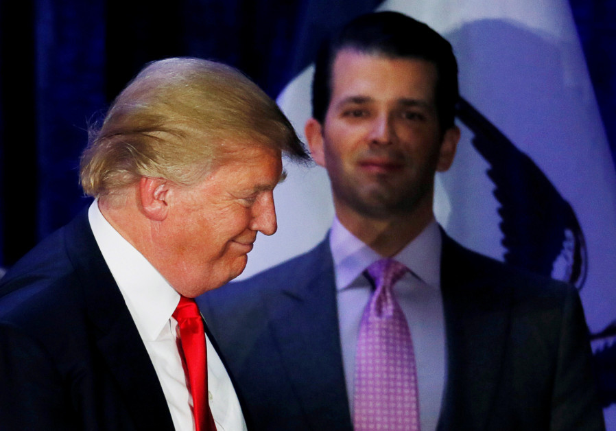 Donald Trump Jr. (R) watches his father Republican US presidential candidate Donald Trump leave the