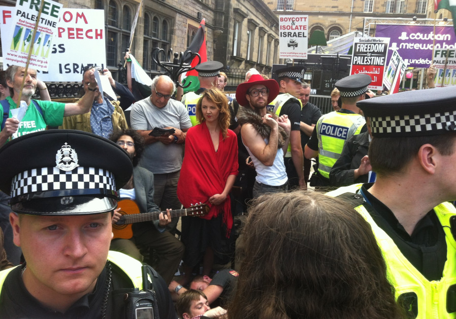 ir play outside amid protests in Edinburgh in 2014.
