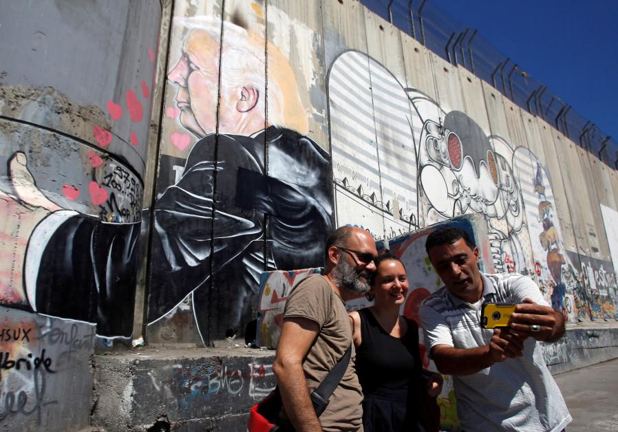 Bethlehem graffiti lampoons Trump's embrace of Israeli security barrier