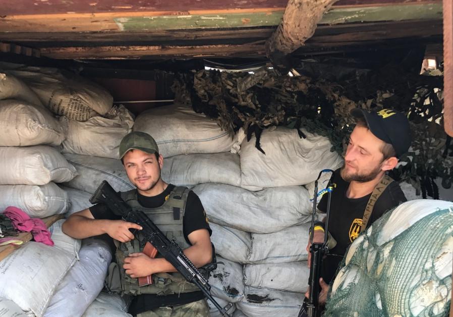 Two Ukrainian Donbas Battalion volunteers at their frontline post
