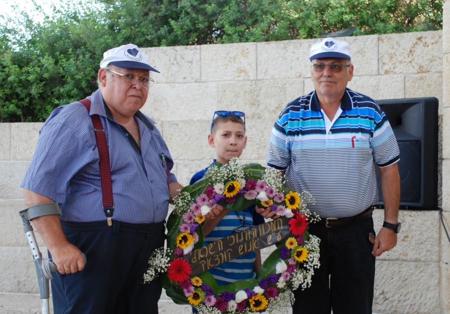 Nadel family members lay a wreath at Yad Vashem