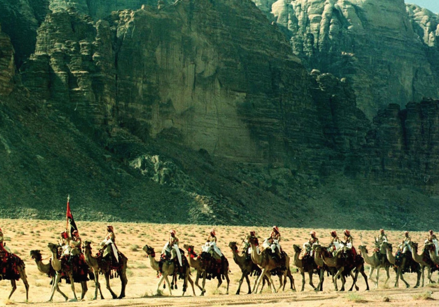 Men on camels near Wadi Rum
