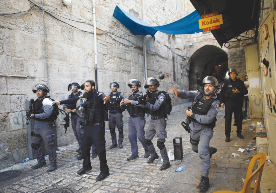 Border police confront protestors in the Old City of Jerusalem.