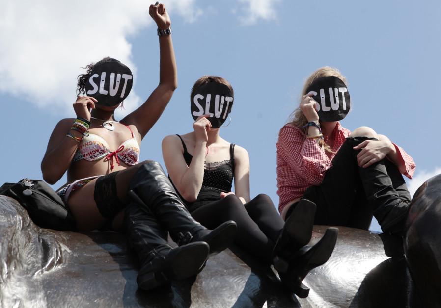 SlutWalk participants cheer a speaker, after walking from Hyde Park Corner, in Trafalgar Square, cen