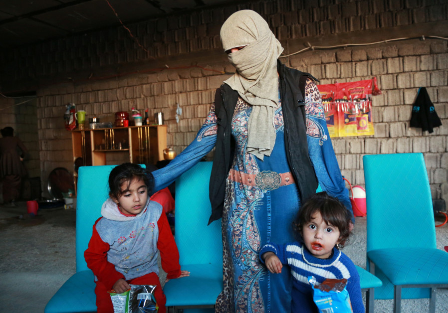 Displaced women and children from the minority Yazidi sect who were kidnapped by Islamic State milit