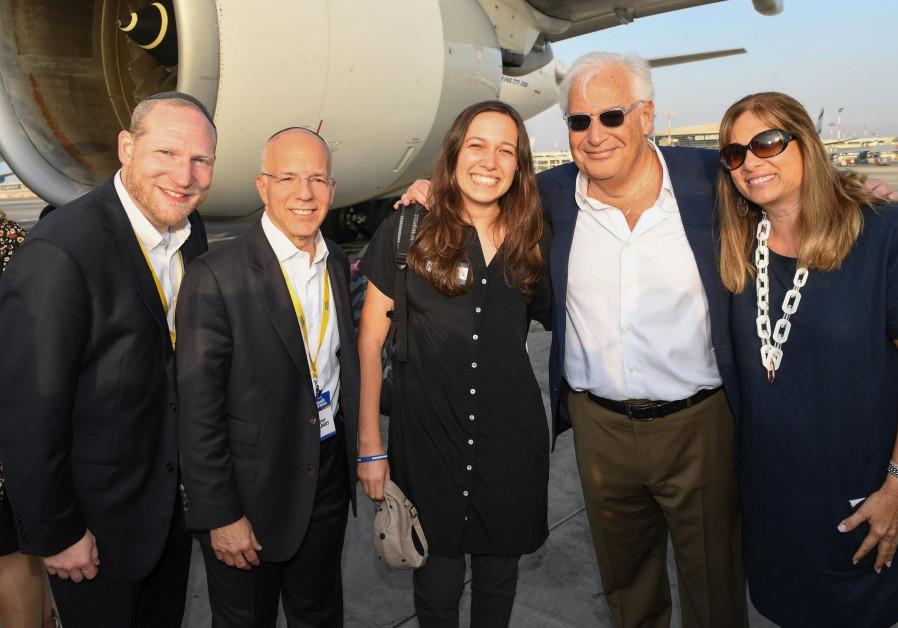 US Ambassador to Israel David Friedman greets his daughter at the airport as she makes aliya