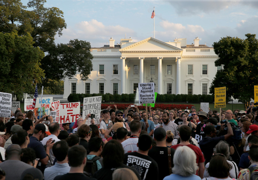 """People gather for a vigil in response to the death of a counter-demonstrator at the """"Unite the Right"""