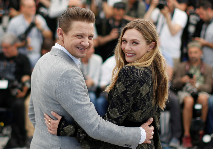 Cast members Jeremy Renner and Elizabeth Olsen pose.