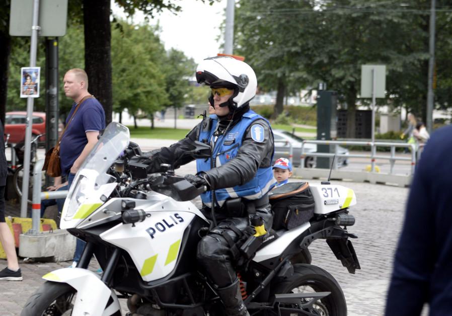 Finnish police patrols on motorbike after stabbings in Turku, in Central Helsinki, Finland 8/8/2017.