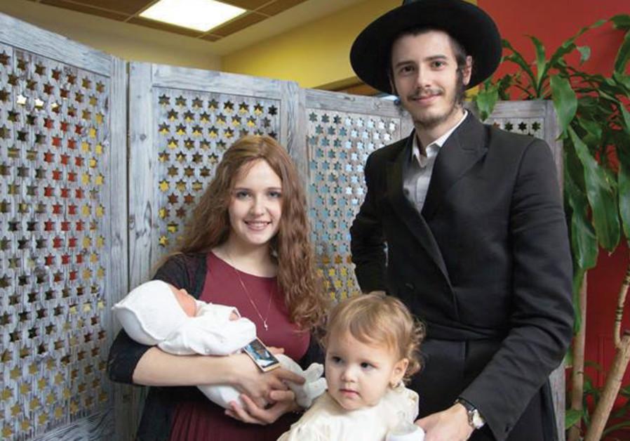 Rachel and David Shapiro with their daughter, Chaya Mushka, and newborn son Menachem Mendel