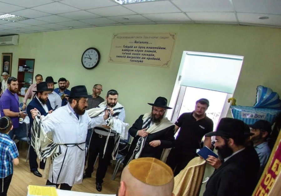 Rabbi Pinchas Vishedsky at the Jewish Community Center for Refugees in Kiev.