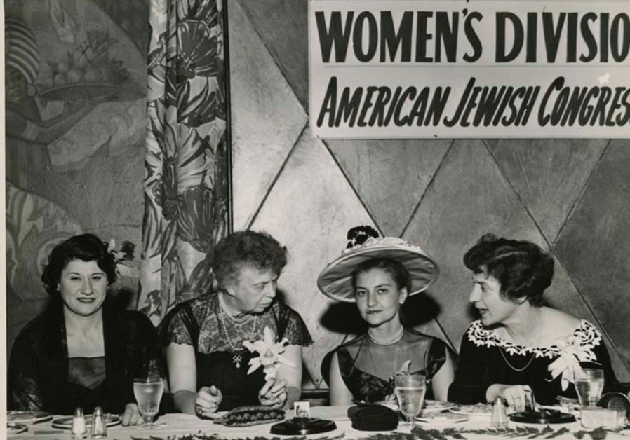 ELEANOR ROOSEVELT (second from left) converses with members of the American Jewish Congress's women'