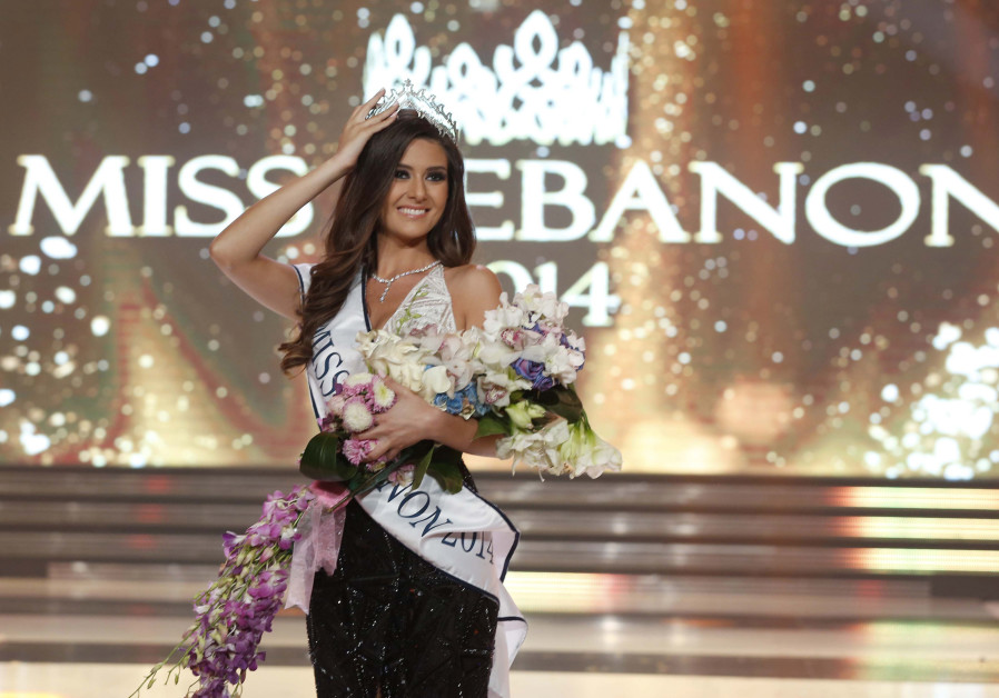 Sally Greige holds her tiara after being crowned Miss Lebanon.