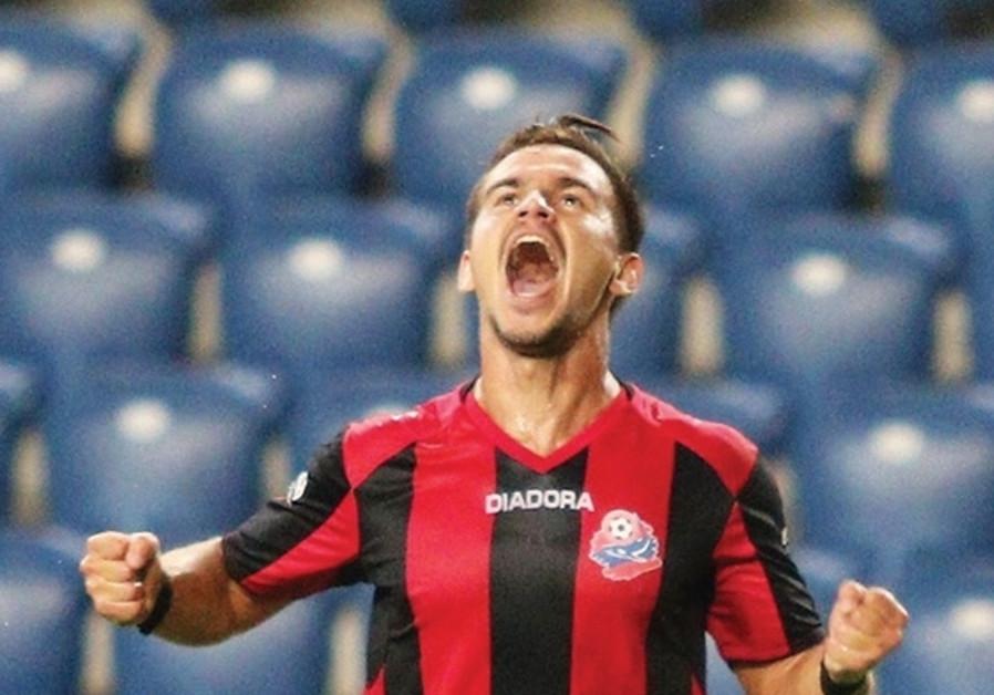 Hapoel Haifa midfielder Maxim Plakuschenko celebrates after scoring his team's second goal in last n