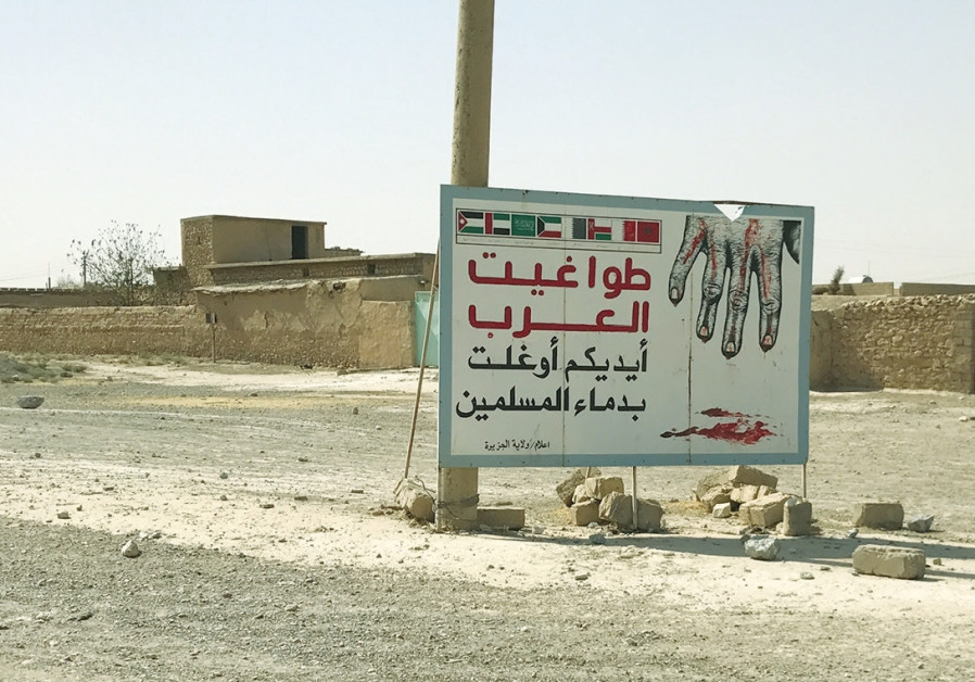 THE SIGN, which says 'Arab tyrants are responsible for the bloodshed of Muslims.'