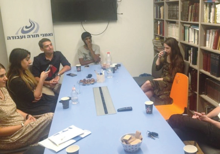 PEOPLE HOLD a discussion at the office of Ne'emanei Torah Va'Avodah, a religious-Zionist lobbying gr
